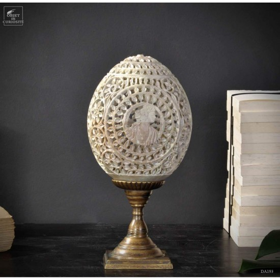 Stone egg, engraved with...