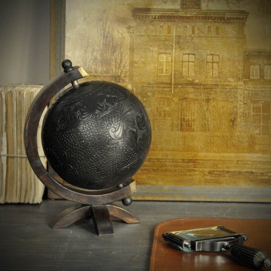 Engraved leather globe on...